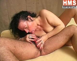 Deep throat sucking mature slut in action