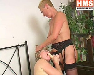 Two mature lesbians and a strap on cock