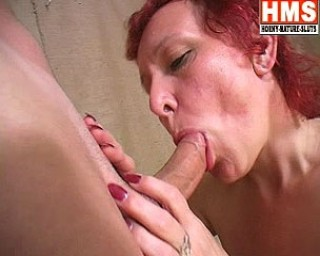 Red mature slut sucking and fucking her ass off